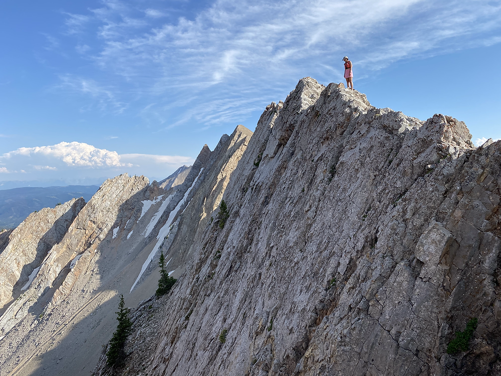 runner perched on a mountain ridge