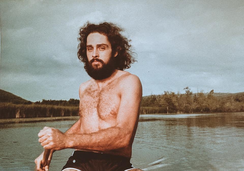 bearded man in canoe