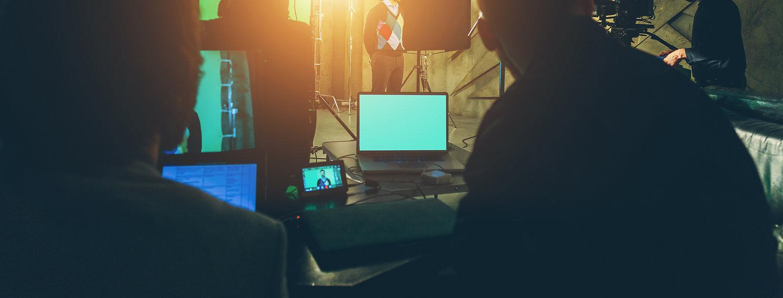 actor in studio posing on green screen.j