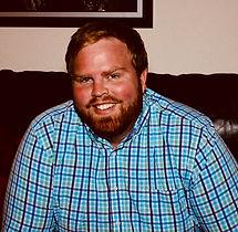 Aaron sitting Med.jpg