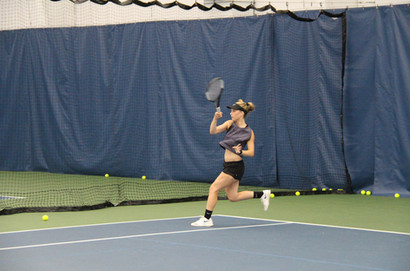 player hitting a forehand