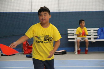kid wearing yellow t-shirt and holding a cone