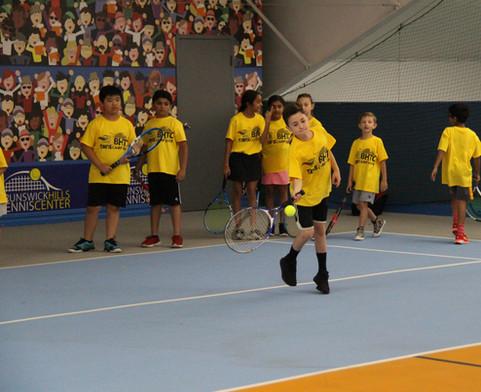 Kid hitting a forehand