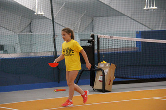 girl wearing yellow t-shirt and holding a cone