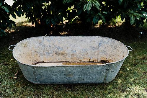 Large galvanised metal bath