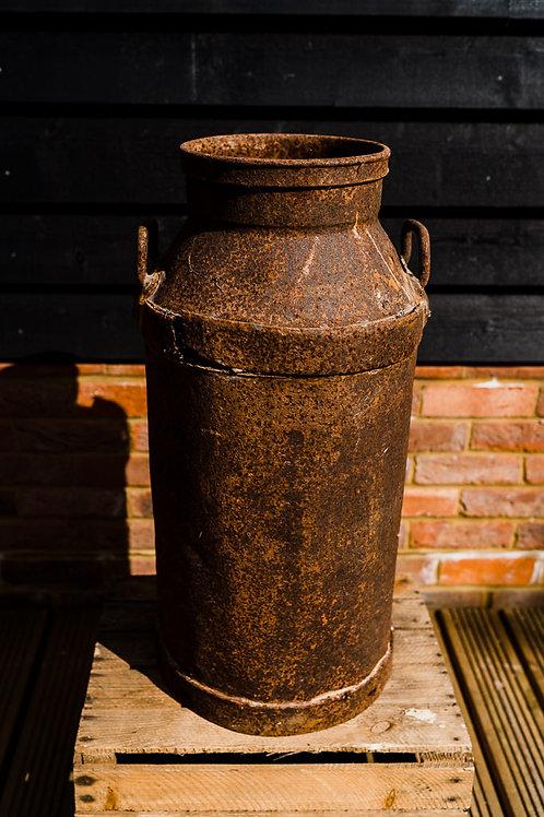 Rusty galvanised milk churns