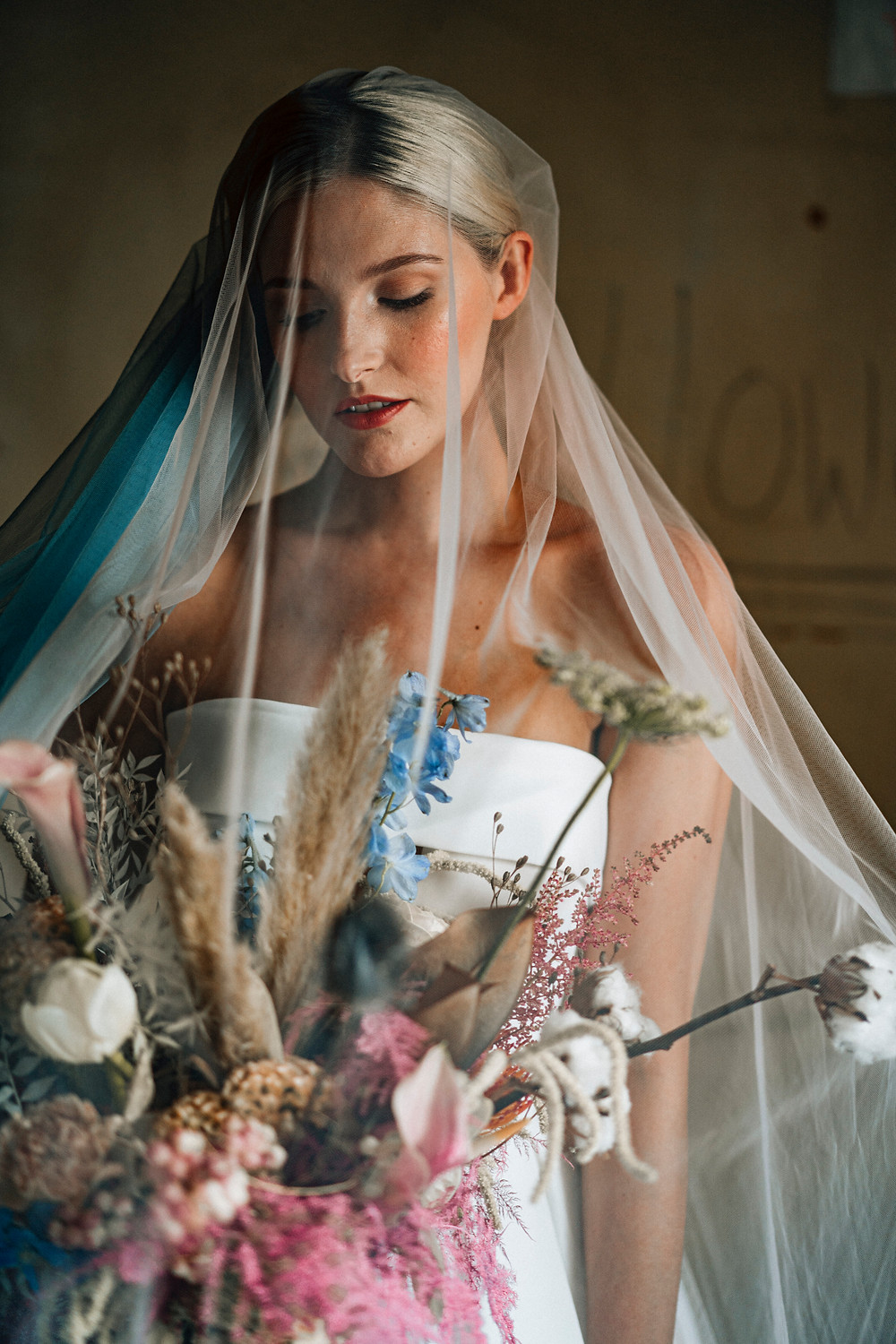 Charlotte Godfrey models a gown by Creatiques, veils by Ashley Wild and florals by Willow and Wisps.  Hair and Make up ID Make up, Hair and Beauty