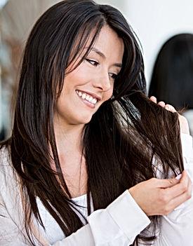 Woman portrait at the hair salon needing