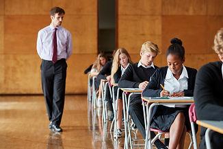 Teenage Students Sitting Examination Wit