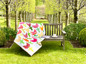 Win a quilt and raise funds for the village