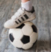 boy-s-foot-soccer-ball-hardwood-floor_23