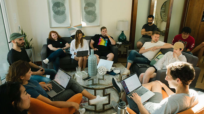 group-of-people-sitting-on-sofa-while-di