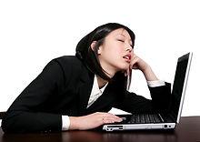 Lady sleeping on Computer.jpeg