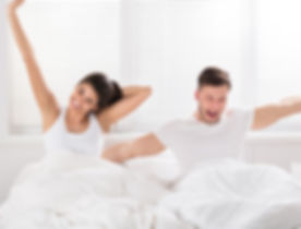 Image Couple Waking Up Happy.jpg