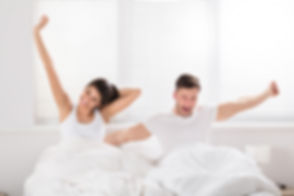 Image Couple Waking Up Happy.jpg