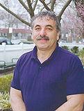 Mr. Charlie Kapighian