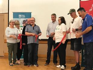 Mayor Rick Goldring cuts the ribbon