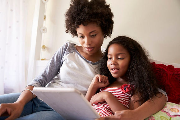 Mother and Daughter Enjoying Virtual Materials on Tablet