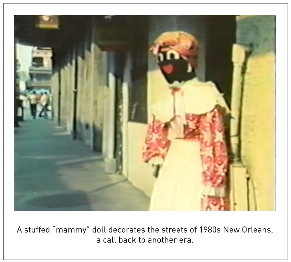 """A stuffed """"mammy"""" doll decorates the streets of 1980s New Orleans, a call back to another era."""