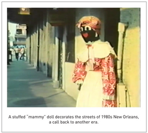 "A stuffed ""mammy"" doll decorates the streets of 1980s New Orleans, a call back to another era."