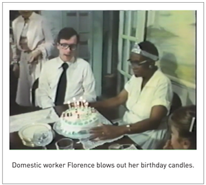 Domestic worker Florence blows out her birthday candles.