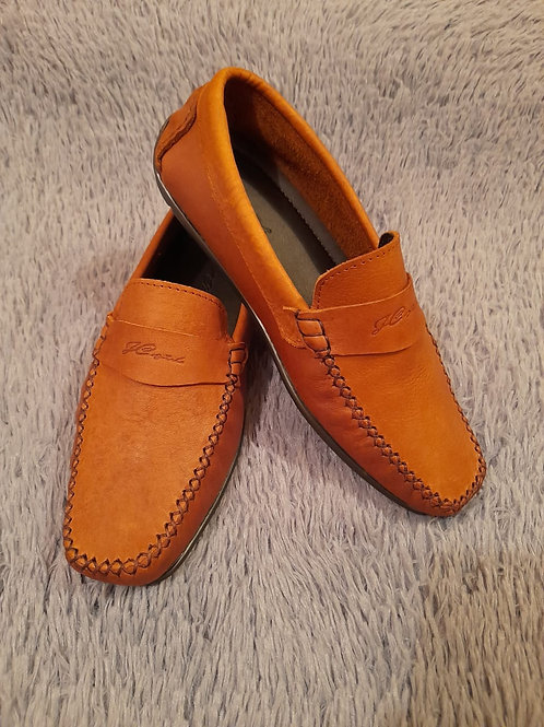 Zapatos en piel auténtica.