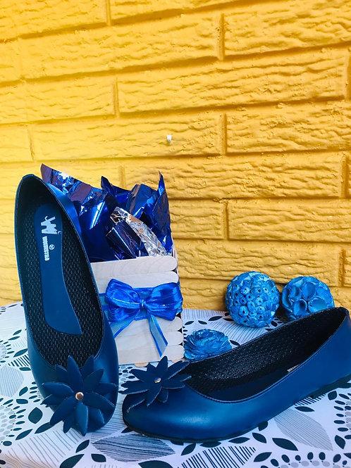 balerina azul con flor