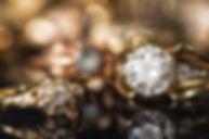 Gold jewelry on a black background..jpg