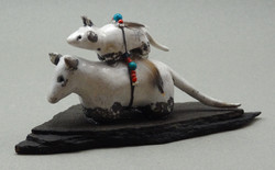 Possum and baby, White Crackle glaze, raku fired, 4 x 2 x 1 inch, mounted on flagstone