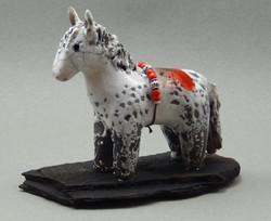 Horse, White Crackle glaze, raku fired, 4 x 3.5 x 1 inch, mounted on flagstone