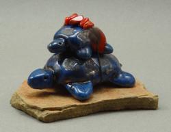 Turtle and baby, Lapis glaze, raku fired, 3.5 x 2 x 2 inches, mounted on flagstone