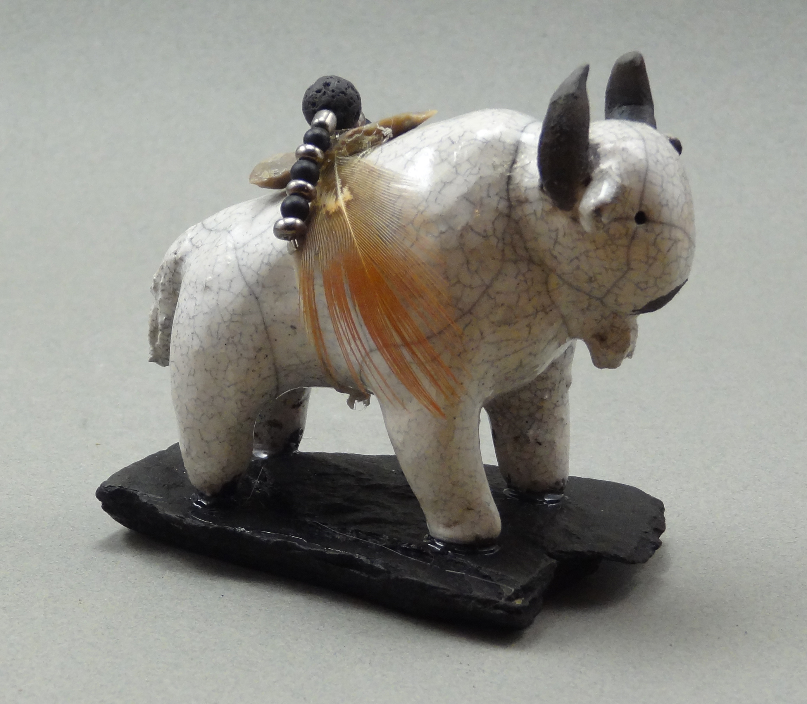 Buffalo, White Crackle glaze, raku fired, 3 x 2.5 x 1.5 inches, mounted on flagstone