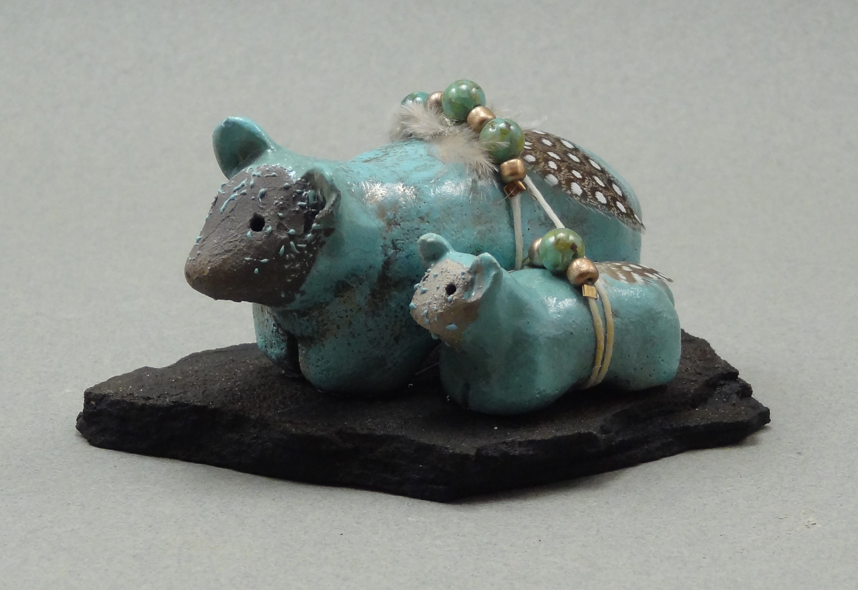Bear and cub, Carribean Blue glaze, raku fired, 3 x 2 x 1 inch, mounted on flagstone