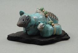 Bear and cub, Carribean Blue glaze, raku fired, 3 x 2 x 1 inch, mounted on flagstone