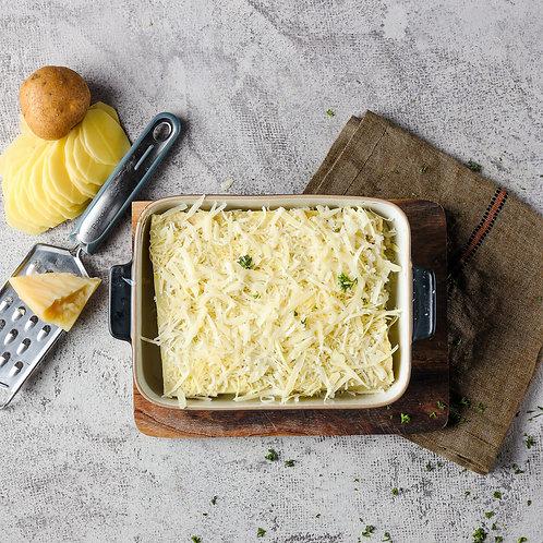 Bulvių sluoksniuotis su trumais ir kietuoju sūriu  (0,5 kg.)