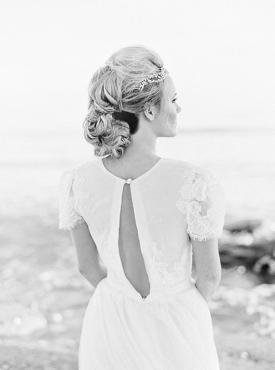 Black and white photo of the back of a boho wedding dress.