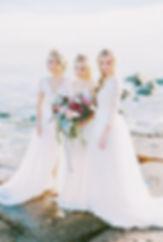 Three bohemian brides by the sea.