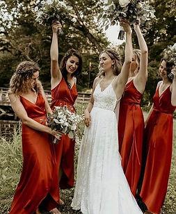 boho-bride-with-bridesmaids-celebrating.