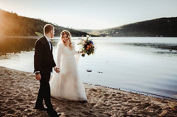 bohemian-bride-with-husband-by-lake.JPG