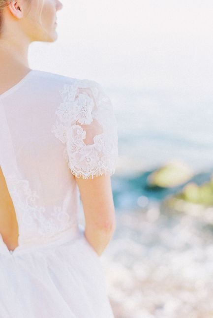 Close up view of the back and sleeves of a short sleeved Flora & Lane boho wedding dress.