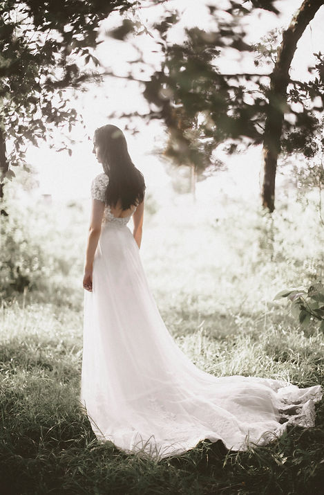 Bride wearing an ethereal wedding gown.