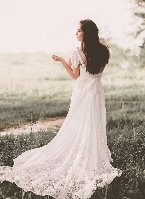 Back view of a Flora & Lane boho bridal gown.