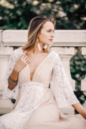 Bride sitting down with a fierce look while in the Lavie gown by Flora & Lane.