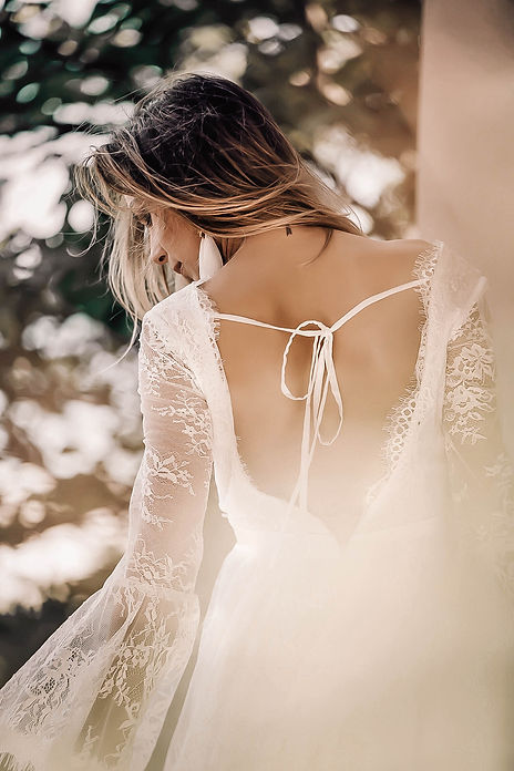 Romantic plunging back of the Primrose gown by Flora & Lane.