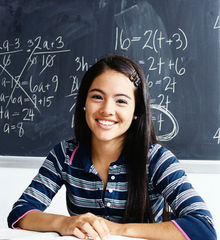 Picture of smiling student in front of chalk board