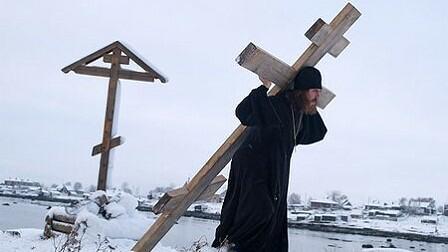 Fr Job bearing his cross