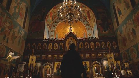 A still from 'The Alternate. A small moment to honour God in the film