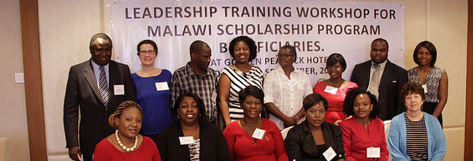 Lead trainers Dr. Maurice Hall (far left, second row) and Dr. Anne Nicotera (second from last on the left, second row) with workshop participants at a Leadership Training Workshop for USAID-Malawi Scholarship Program Beneficiaries.