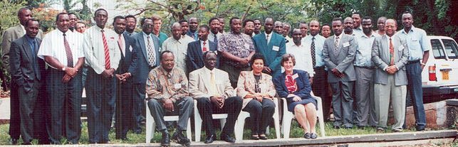 Dr. Lucie Phillips, seated far right, with Tanzanian staff at a workshop.