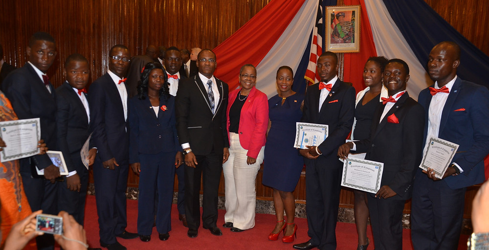 USAID-GEMS Chief of Party Vicki Cooper poses with graduates in the President's Young Professionals Program (PYPP), a fellowship funded by USAID-GEMS that places recent graduates into traineeships with government ministries.